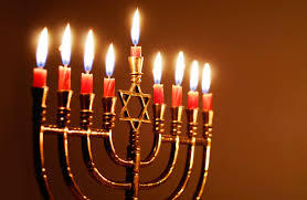 A lit menorah of the type that might be used in Jewish households.